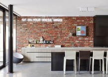 Contemporray kitchen with brick wall and illuminated sign