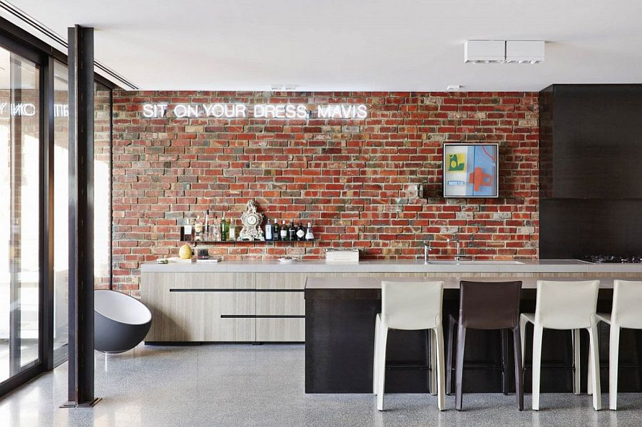 Contemporwray itchen with brick wall and illuminated sign