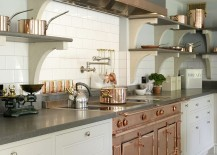 Copper and stainless steel utensils add metallic glint to the Edwardian kitchen 217x155 Gorgeous Bespoke Kitchen Combines Modern Luxury with Edwardian Charm