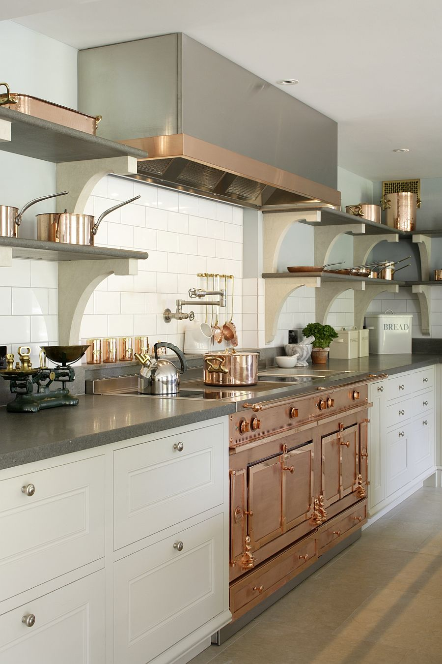 Copper and stainless steel utensils add metallic glint to the Edwardian kitchen