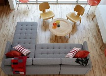 Cozy gray couch with red accents in the living area