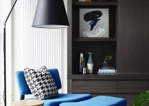 Cozy sitting area with a plush chair and ottoman in blue 217x155 Refined Modern Extension Gives Classic Spanish Mission Home a Facelift