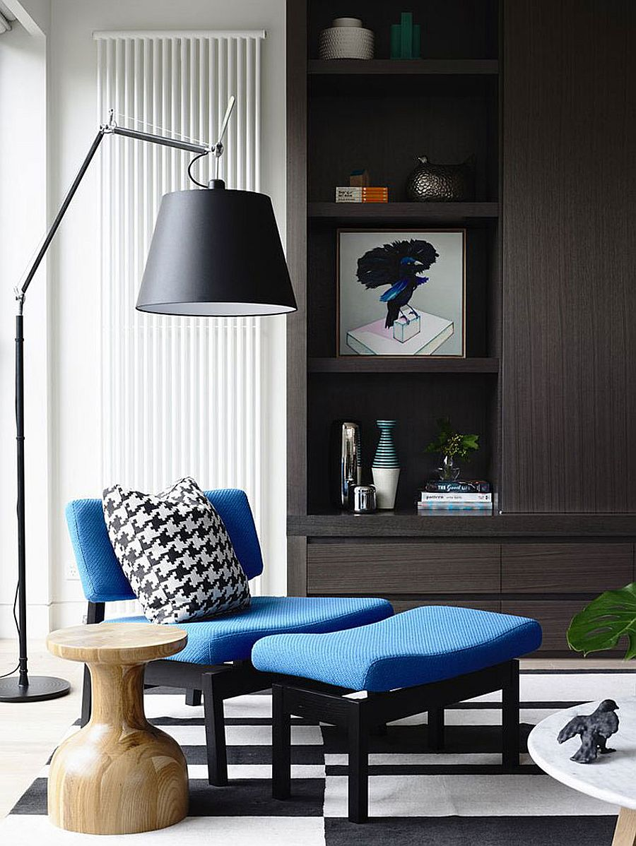 Cozy sitting area with a plush chair and ottoman in blue