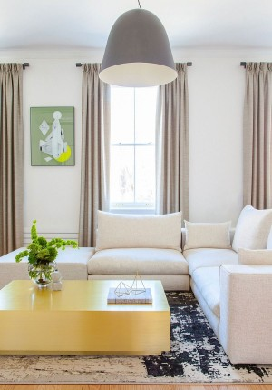 Custom brass coffee table and oversized pendant in the Chelsea apartment living room