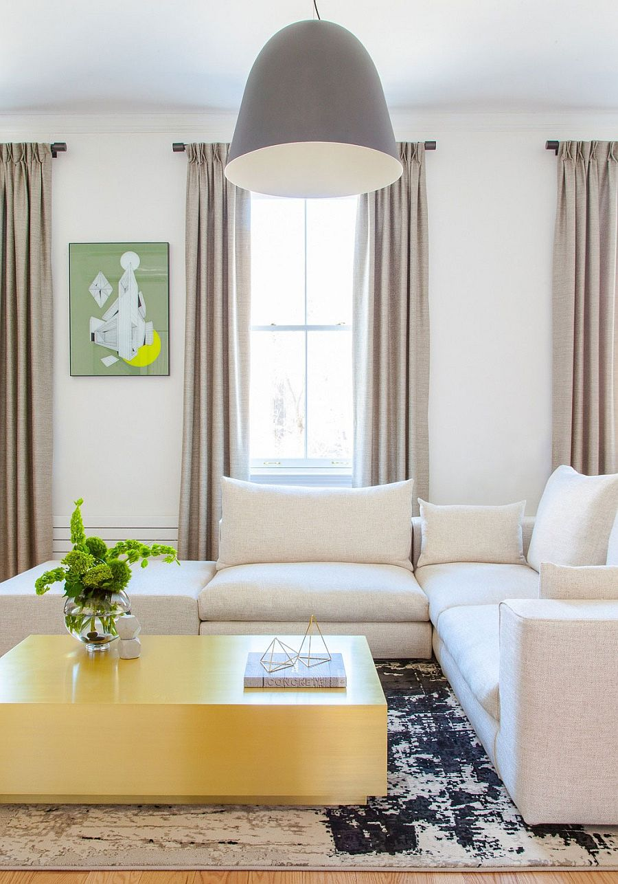 Custom brass coffee table and oversized pendant in the Chelsea apartment living room Delightful Duplex Apartment with Custom Decor and Colorful Bliss!