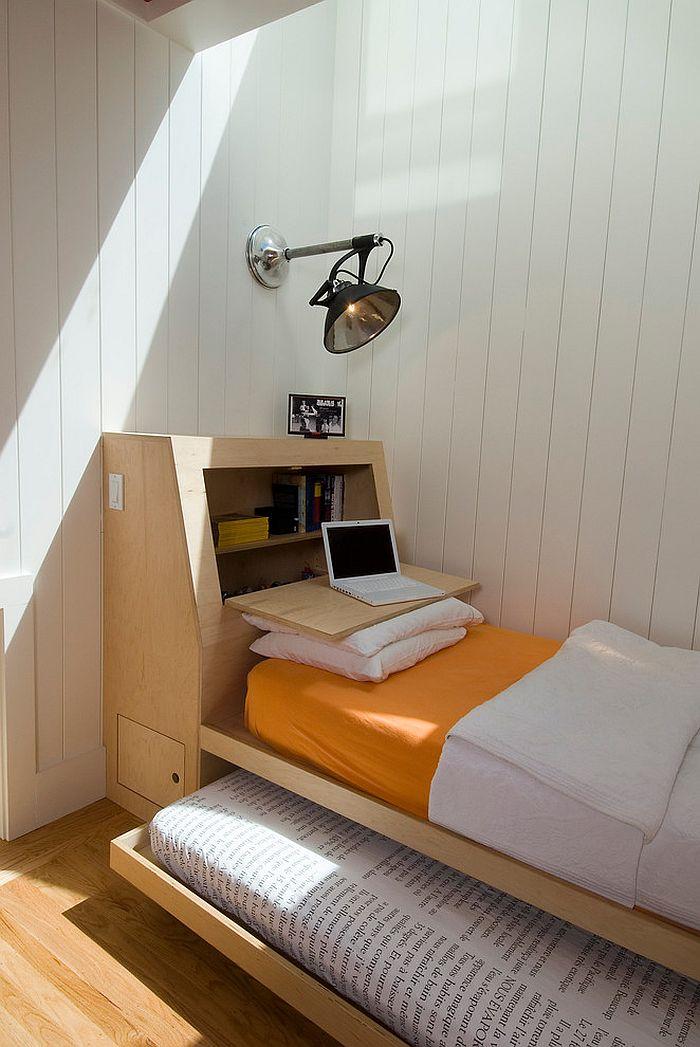 Custom designed bed with a drop-lead desk in the headboard [Design: Malcolm Davis Architecture]