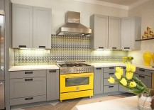 Custom made tempered glass backsplash adds pattern to the kitchen