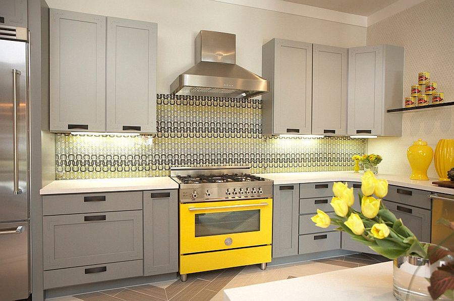 Custom made tempered glass backsplash adds pattern to the kitchen [Design: Dallas Renovation Group]