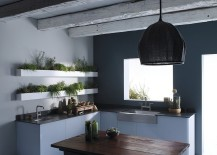 Custom shelves in the kitchen are perfect for a cool, indoor herb garden
