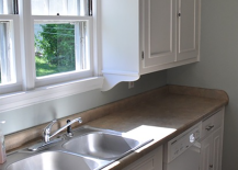 DIY-molding-added-to-kitchen-cabinets-for-50-217x155