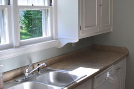 DIY molding added to kitchen cabinets for $50  8 Low-Cost DIY Ways to Give Your Kitchen Cabinets a Makeover DIY molding added to kitchen cabinets for 50 270x180