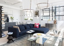 Dark blue couch becomes the focal point in the Scandinavian living room