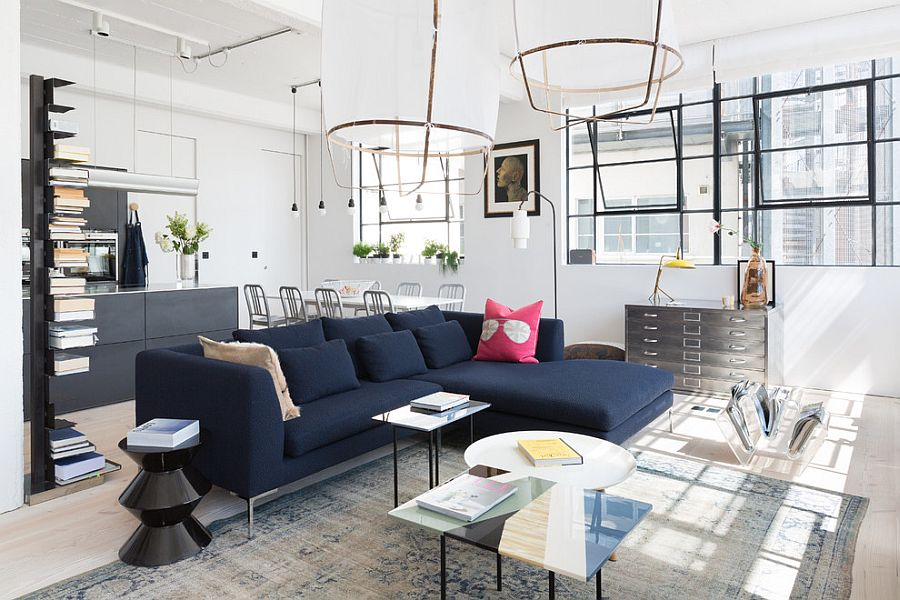 Dark blue couch becomes the focal point in the Scandinavian living room [Design: Cloud Studios]
