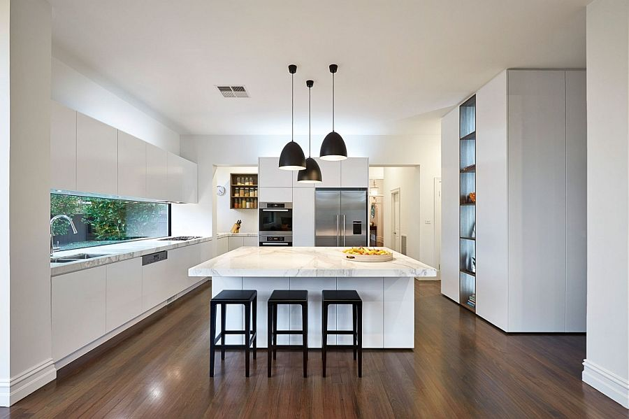 Dark pendant lights offer wonderful visual contrast in the kitchen