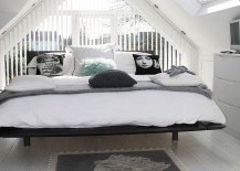 Dashing attic bedroom in black and white