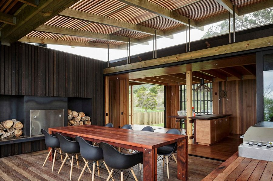 Design of the ceiling and large windows bring in ample light