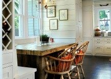 Dining-table-in-heavy-wood-and-a-birdcage-pendant-give-this-dining-room-distinct-personality-217x155