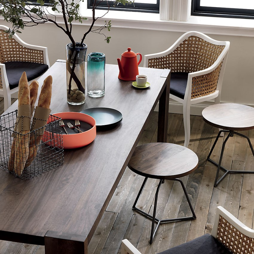 Eclectic dining room with wood and metal stools