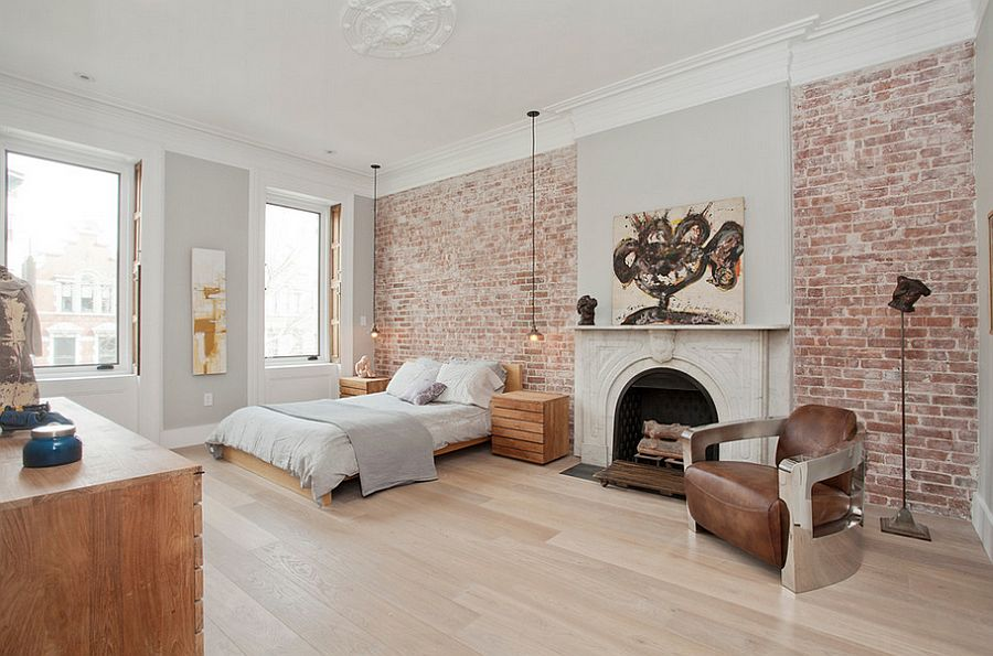 Exposed brick wall brings textural beauty to the posh bedroom [Design: Jensen C. Vasil Architect]