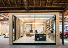 Exquisite office crafted from wood and glass with organized interior