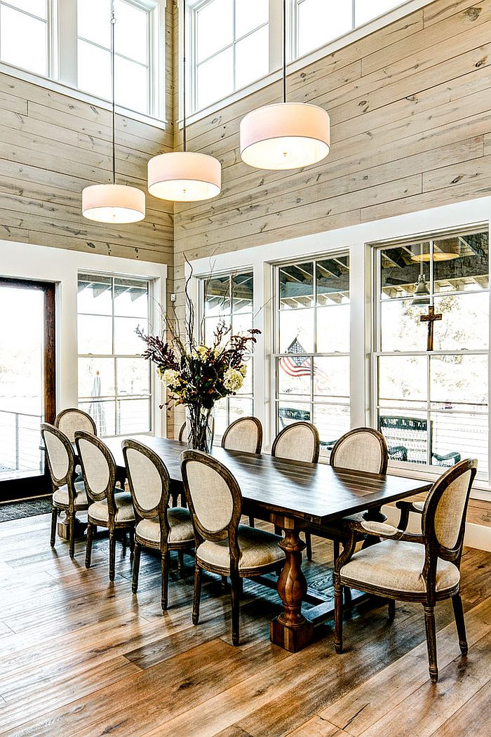 Farmhouse style dining room with high ceiling and glass windows [Design: MSA Architecture + Interiors]