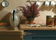 Fascinating use of natural stone inside the country chic kitchen