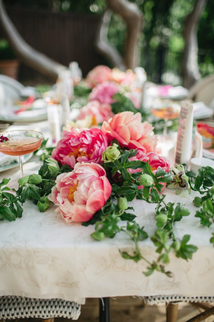 Floral table runner at an outdoor garden party
