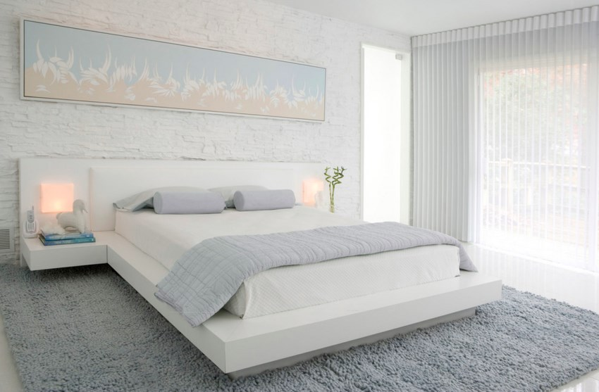 Gauzy white curtains in a modern bedroom