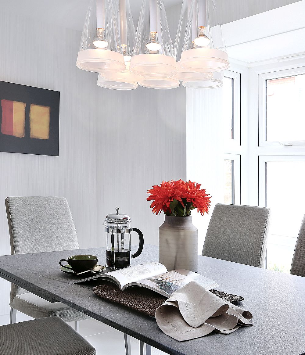 Gorgeous Fuchsia pendants and cool color palette shape the dining room