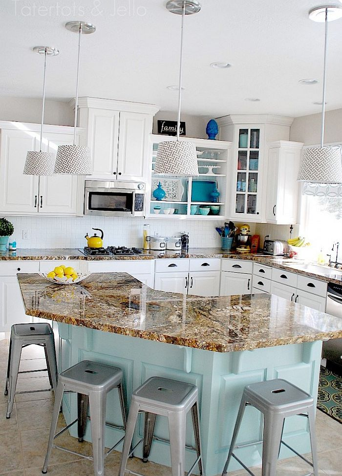 Gorgeous kitchen in aqua and white with open cabinetry