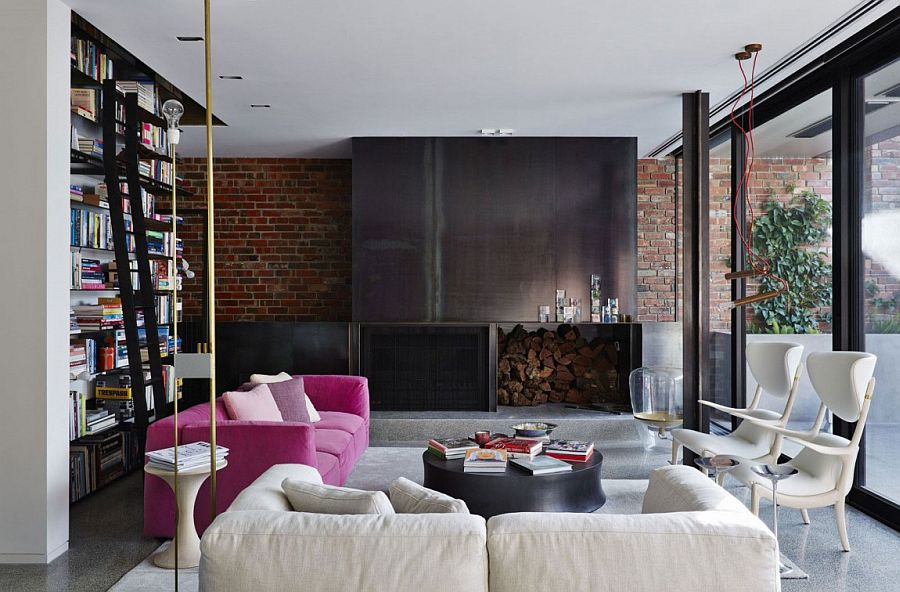 Gorgeous use of color and texture in the elegant living room with brick wall
