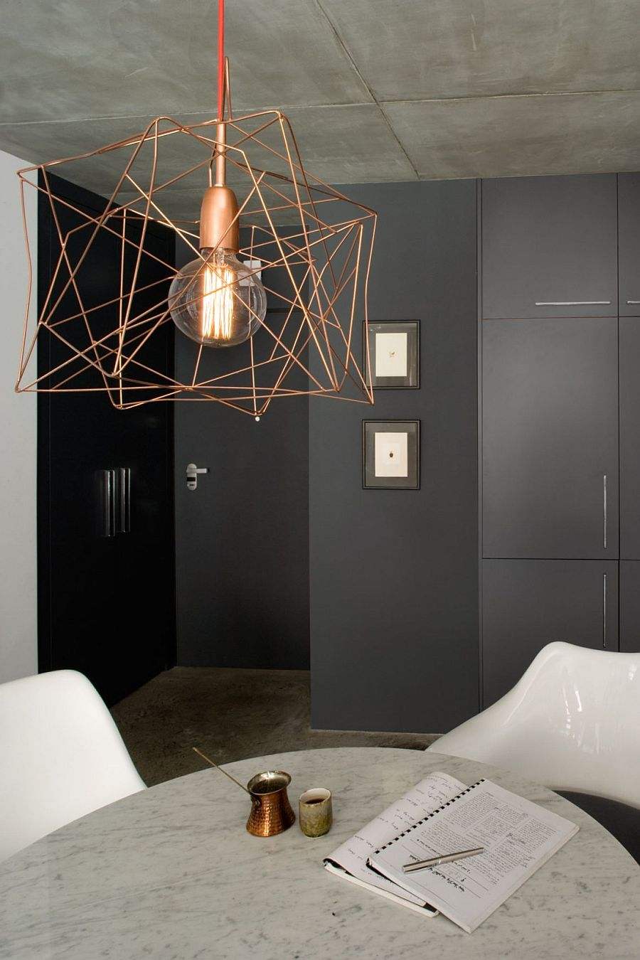 Gray backdrop and snazzy lighting add to the appeal of the quirky, small apartment
