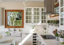 Herb-pots-also-bring-metallic-glint-to-the-kitchen-217x155