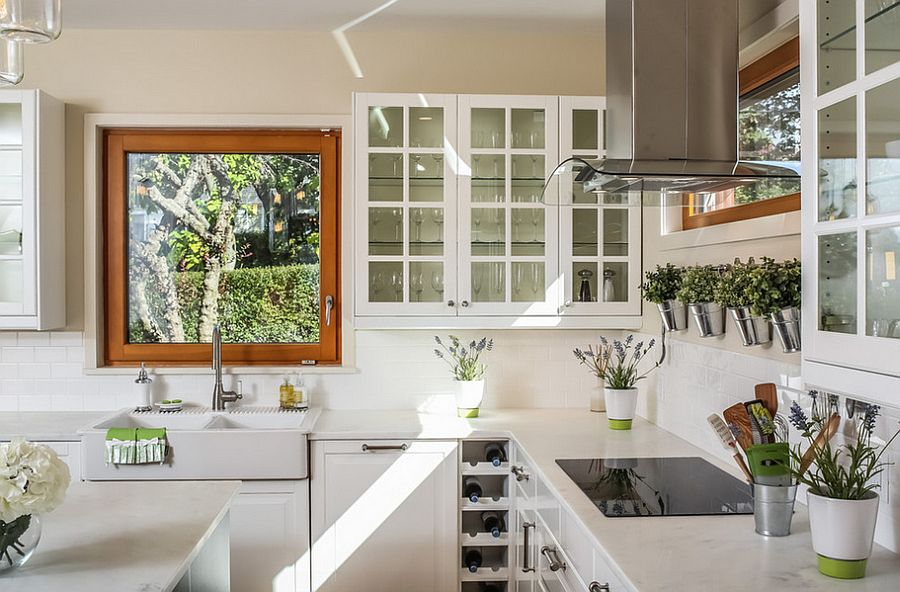 Herb pots also bring metallic glint to the kitchen [Design: A.M. Benzing Architects]