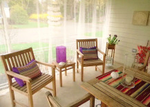 IKEA curtains provide mosquito protection on this porch
