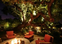 Illuminated oak tree by an outdoor fire pit 217x155 10 Backyard Getaways with Landscape Lighting