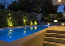 Illuminated pool area with a spherical outdoor lamp
