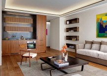 Interior-with-neutral-color-palette-and-wall-art-adding-pops-of-color-217x155
