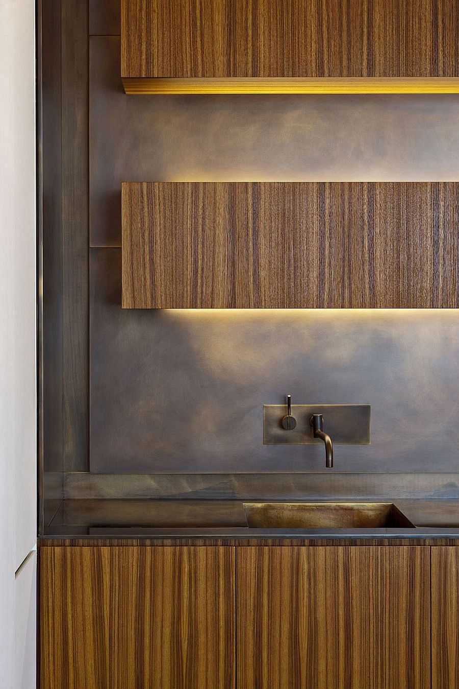 LED strip lighting gives the floating kitchen cabinets a surreal aura