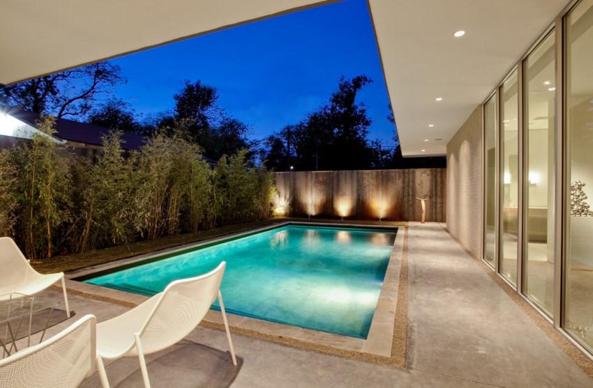Landscape lighting against a backyard fence