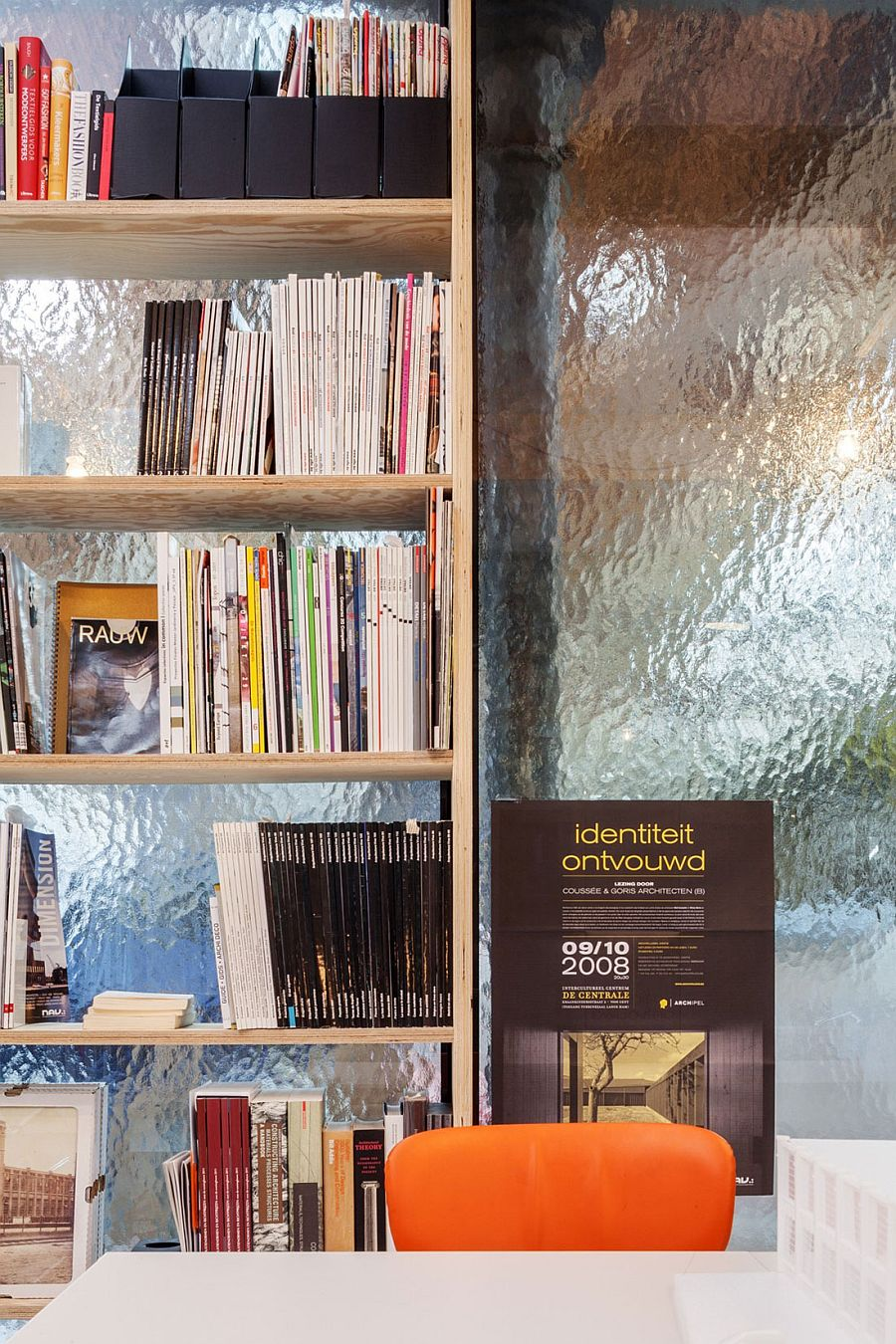 Large bookshelf in the home office with a frosted glass backdrop