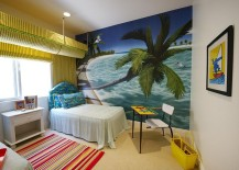 Large wall mural ushers in the tropical vibe in this colorful bedroom