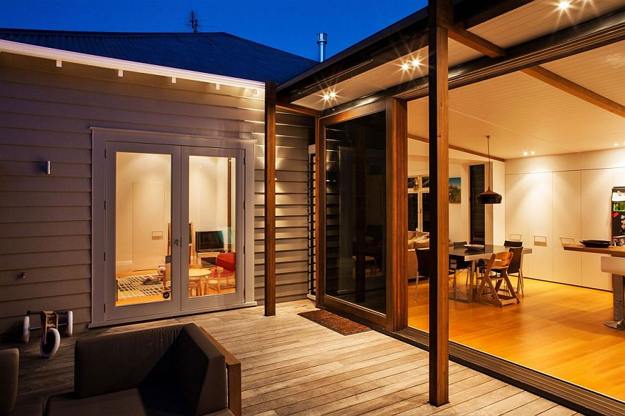 Lighting inside the house adds to the ambiance of the deck