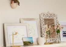 Living room floating shelf decorating idea with shabby chic style