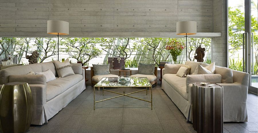 Living room with expansive window that brings the garden greenery indoors