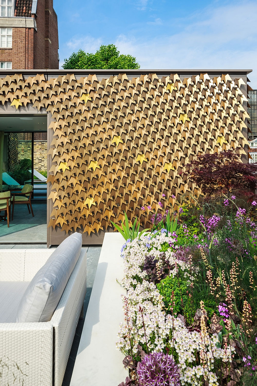 London Residence Outdoor Area with Folded Metal Leaves Facade