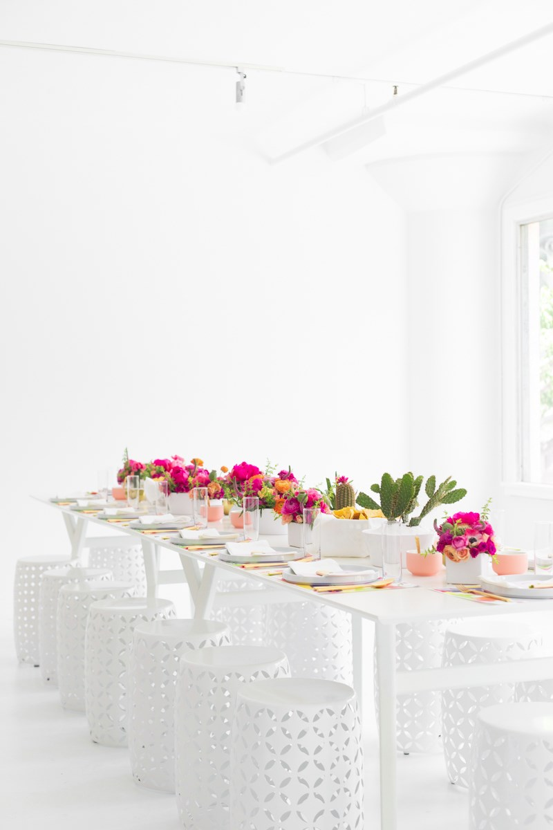 Long party table with white stools