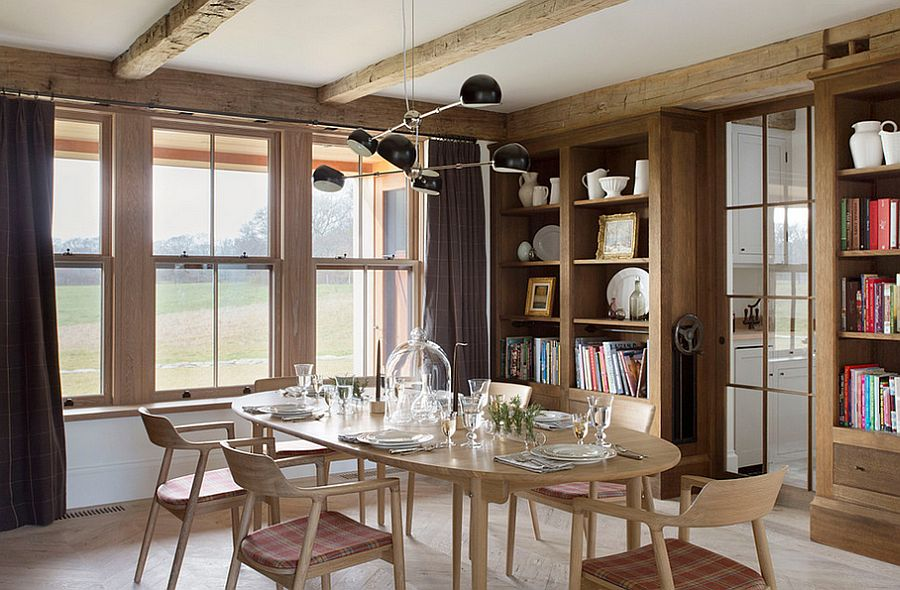 Lovely use of books to decorate the farmhouse dining room [Design: David Nelson & Associates]