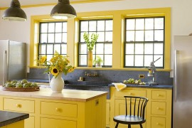 unique gray backdrop and pops of yellow enliven this eclectic kitchen