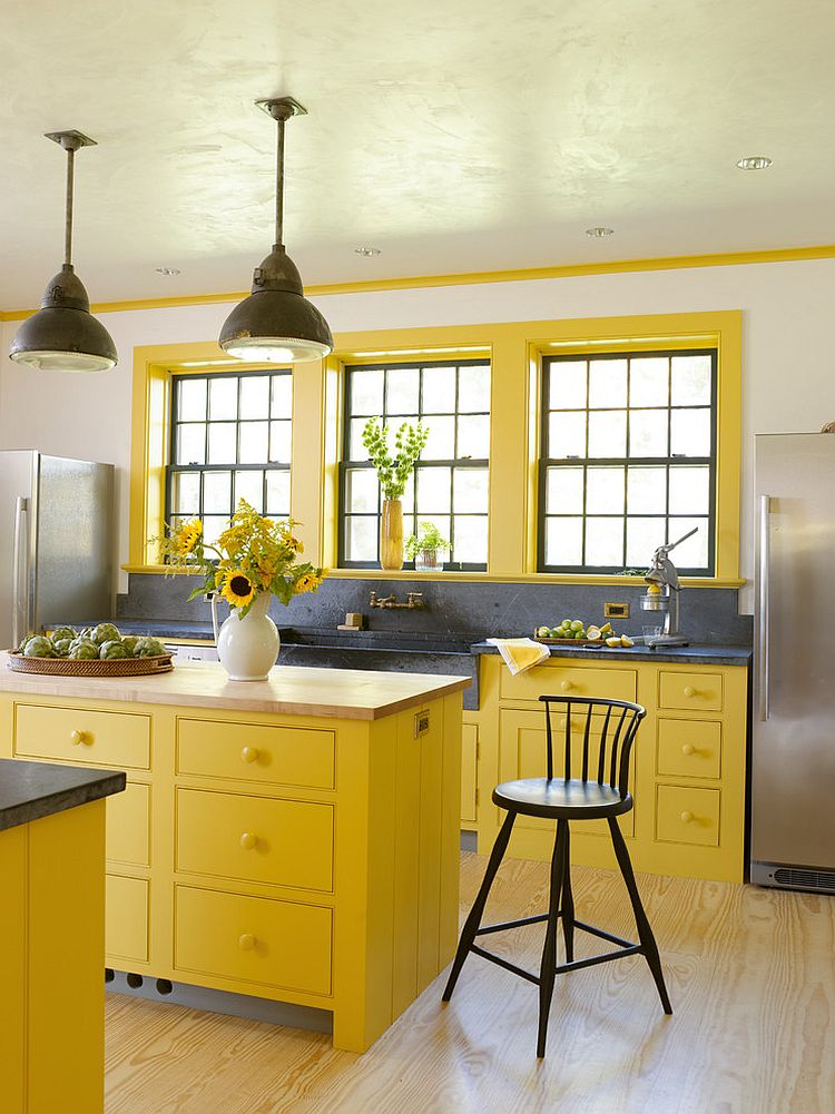 View in gallery Lovely use of bright yellow in the farmhouse style kitchen  [Design: Rafe Churchill: